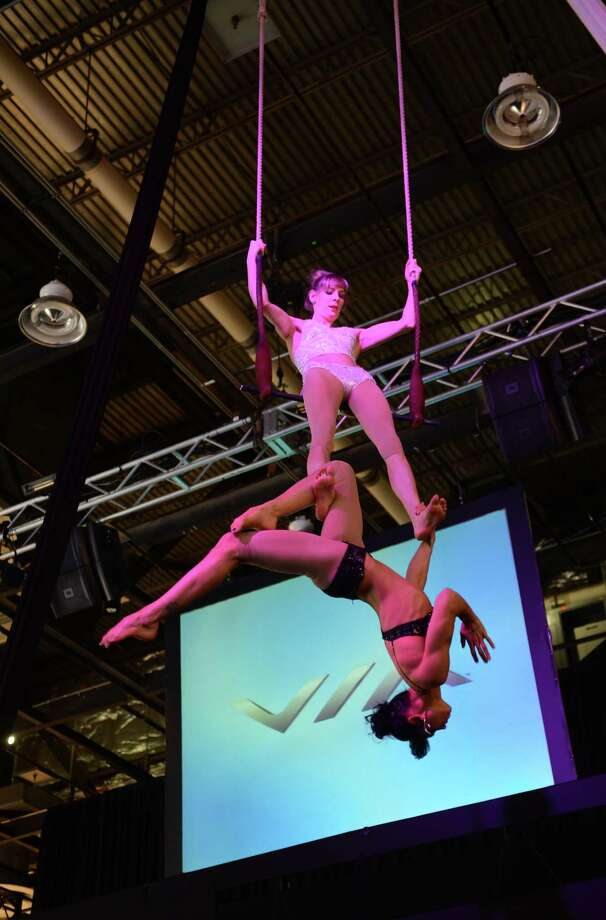 Trapeze artists Duo perform at the Via Motors press conference at the 2013 North American International Auto Show in Detroit, Michigan, on January 14, 2013. AFP PHOTO/Stan HONDA Photo: .