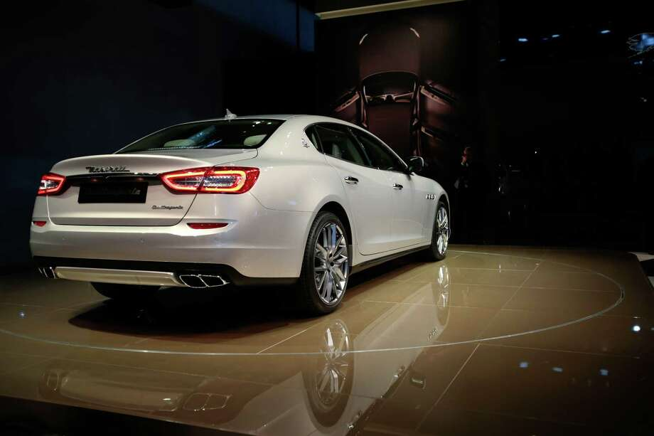 The Maserati Quattroporte is introduced at the 2013 North American International Auto Show in Detroit, Michigan, on January 14, 2013.     AFP PHOTO/Geoff Robins Photo: GEOFF ROBINS, . / 2013 AFP