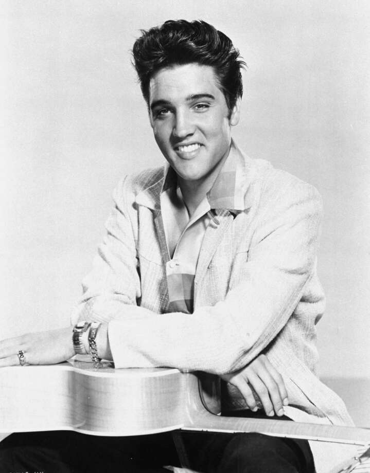 "** ADVANCE FOR Thursday, July 1--FILE **Elvis Presley is shown in this 1957 file photo. On July 5, 50 years to the day that Elvis recorded ""That's All Right,"" media and fans from around the world will converge in Memphis for a blowout celebration to commemorate the song, which has been labeled by the city and others as the tune that started the musical and cultural phenomenon known as rock 'n' roll.  (AP Photo/FILE) / MGM"