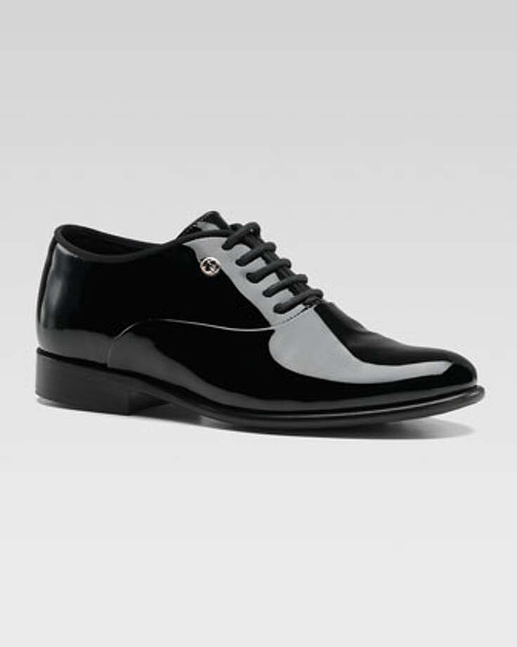 Gucci tuxedo shoes, $310. Just what every little tuxedo-wearing boy needs! neimanmarcus.com