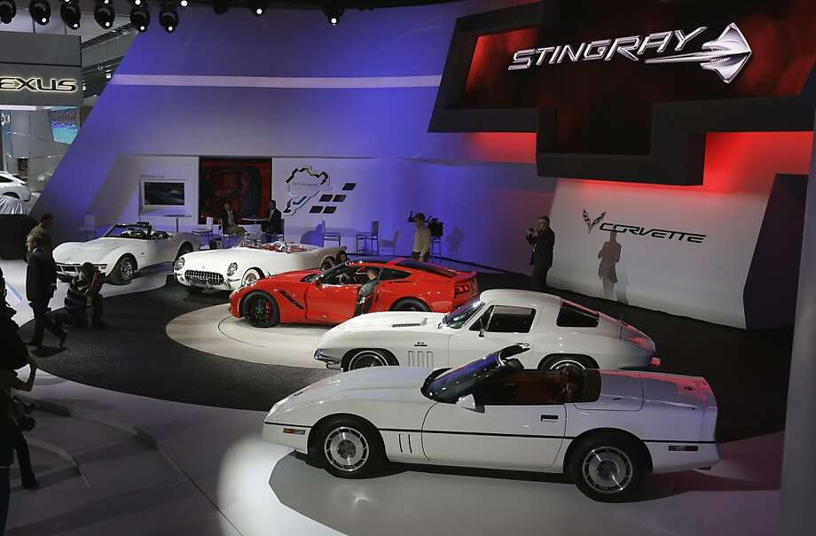 The Chevrolet Corvette Stingray,  in red, is seen with previous models during media previews for the North American International Auto Show in Detroit, Monday, Jan. 14, 2013. Photo: Carlos Osorio, Associated Press