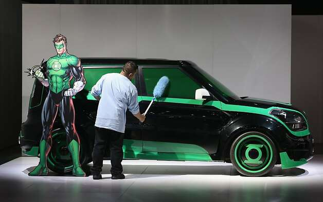 DETROIT, MI - JANUARY 14:  Angel Palizio dusts a Kia Soul with the DC Comics package during the media preview at the North American International Auto Show on January 14, 2013 in Detroit, Michigan. The auto show will be open to the public January 19-27. Photo: Scott Olson, Getty Images