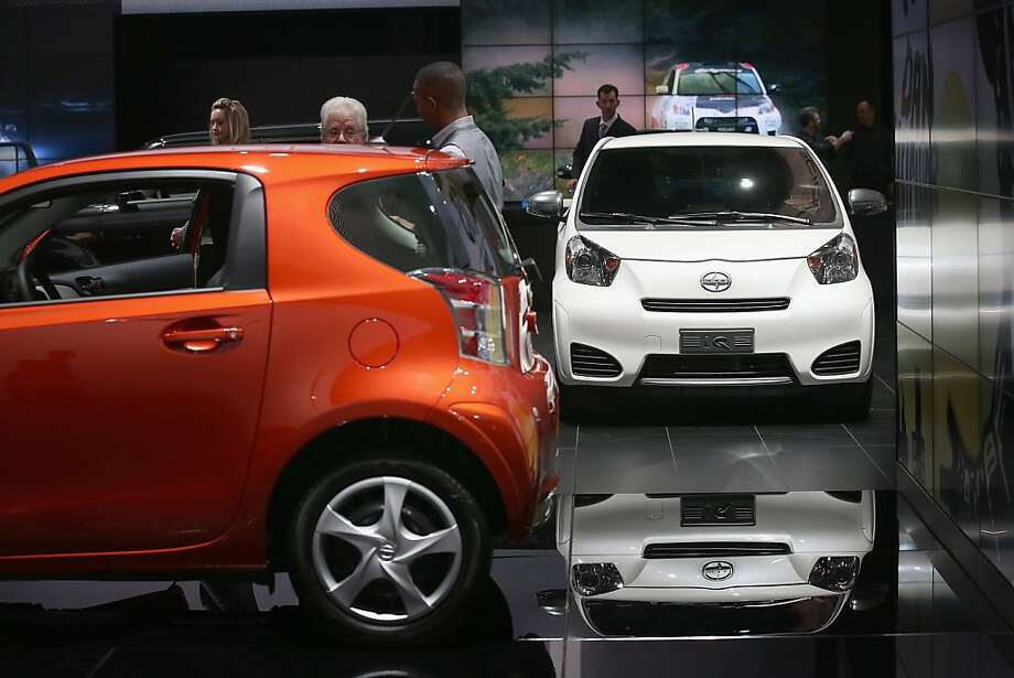 DETROIT, MI - JANUARY 14: Visitors look over the Scion iQ during the media preview at the North American International Auto Show on January 14, 2013 in Detroit, Michigan. The auto show will be open to the public January 19-27. Photo: Scott Olson, Getty Images