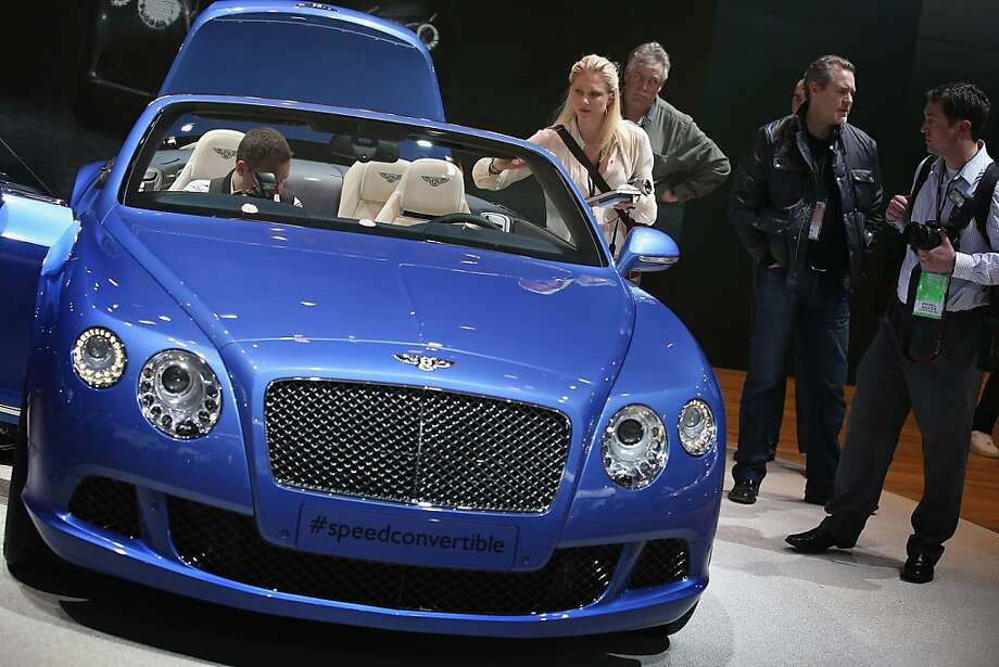 DETROIT, MI - JANUARY 14:  Visitors look over a 202 MPH Bentley Continental GT Speed Convertible during the media preview at the North American International Auto Show on January 14, 2013 in Detroit, Michigan. The auto show will be open to the public January 19-27. Photo: Scott Olson, Getty Images