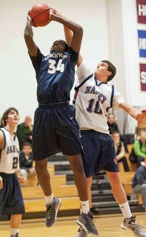 Harvey School's Andrew Schwartz does his best to try to block a shot by King School's Guilbert Francois in a boys varsity basketball game played at King school, Stamford, CT on Monday January 14th, 2013 Photo: Mark Conrad / Stamford Advocate Freelance