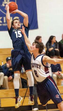 King School's Conor Harris takes a jump shot from the corner in a boys varsity basketball game played against the Harvey School at King school, Stamford, CT on Monday January 14th, 2013 Photo: Mark Conrad / Stamford Advocate Freelance
