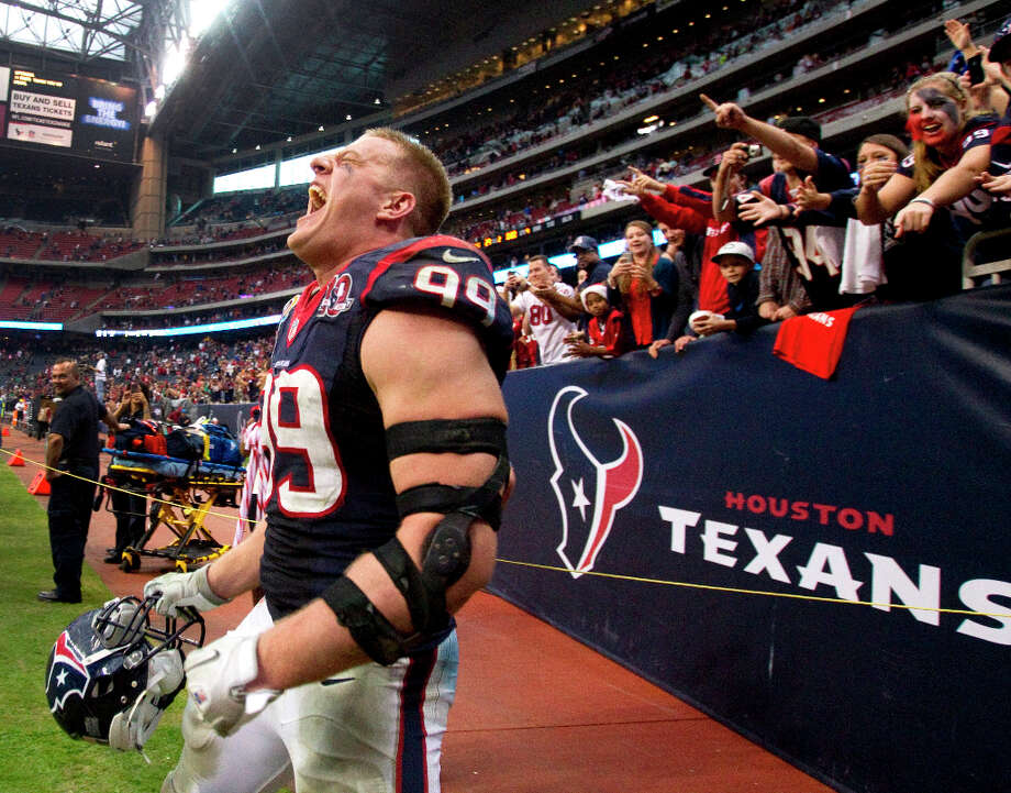 If you write a really amazing rap song about the Houston Texans, J.J. Watt will probably not stand around checking his cell phone and looking tough in the background of your music video. Photo: Brett Coomer / © 2012  Houston Chronicle
