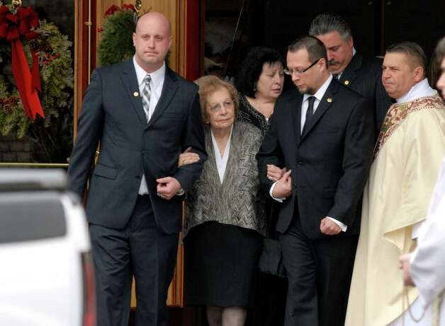 Louise Esposito leaves the funeral service for her husband former Norwalk Mayor Frank Esposito on Monday January 14, 2013 at St. Matthews Church in Norwalk, Conn. Photo: Dru Nadler / Stamford Advocate Freelance