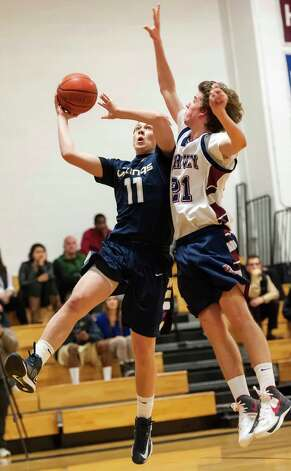 King School's Angus Bass goes up for a shot in a boys varsity basketball game against the Harvey School played at King school, Stamford, CT on Monday January 14th, 2013 Photo: Mark Conrad / Stamford Advocate Freelance