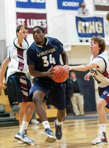 King School's Guilbert Francois trying to go up for a shot in a boys varsity basketball game against the Harvey School played at King school, Stamford, CT on Monday January 14th, 2013 Photo: Mark Conrad / Stamford Advocate Freelance