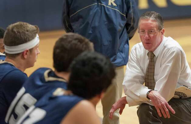 King School boys varsity basketball head coach Greg Dobbs speaks to his team during a break in a game against the Harvey School played at King school, Stamford, CT on Monday January 14th, 2013 Photo: Mark Conrad / Stamford Advocate Freelance