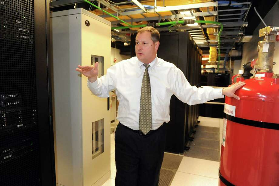 Dan Maynard, vice president and general manager talks about the fire extinguisher system in the customer data center on Wednesday, Jan. 9, 2013, at tw telecom in Colonie, N.Y. (Cindy Schultz / Times Union) Photo: Cindy Schultz / 00020686A