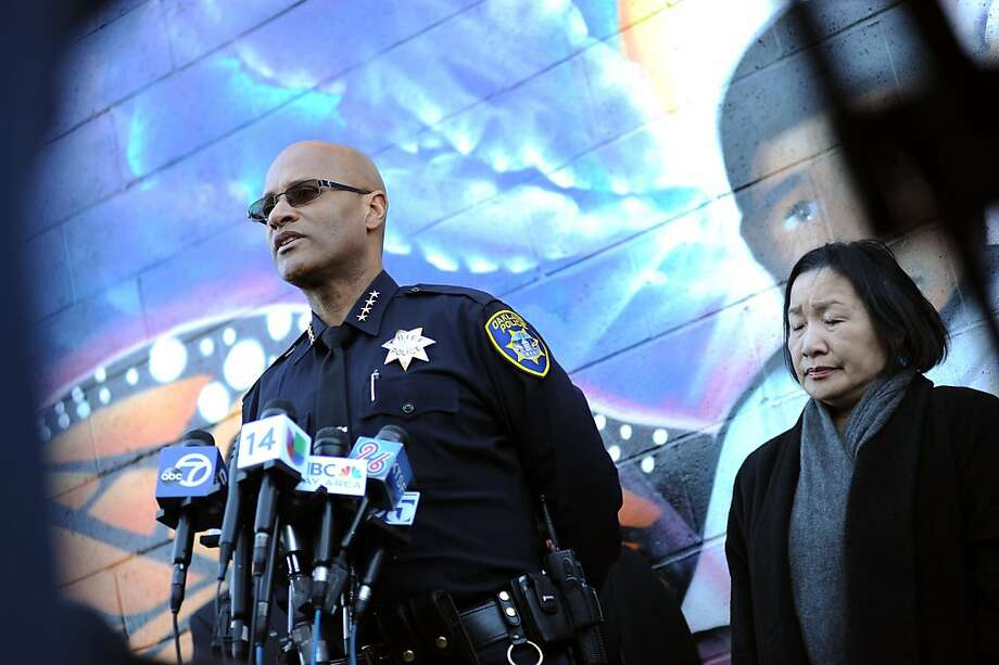 Oakland Police Chief Howard Jordan(L) and Mayor Jean Quan  stand in front of a mural of 3 year old homicide victim Carlos Nava on International Blvd. as the Cheif addresses the gathered media.   Oakland police, Mayor Jean Quan and City Administrator held a news conference to discuss the ongoing violence gripping Oakland, Monday January 14th, 2013. Photo: Michael Short, Special To The Chronicle