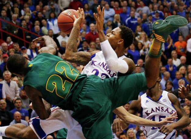 Baylor guard A.J. Walton (22) blocks a shot by Kansas guard Ben McLemore (23) during the first half of an NCAA college basketball game in Lawrence, Kan., Monday, Jan. 14, 2013. (AP Photo/Orlin Wagner) Photo: Orlin Wagner, Associated Press / AP