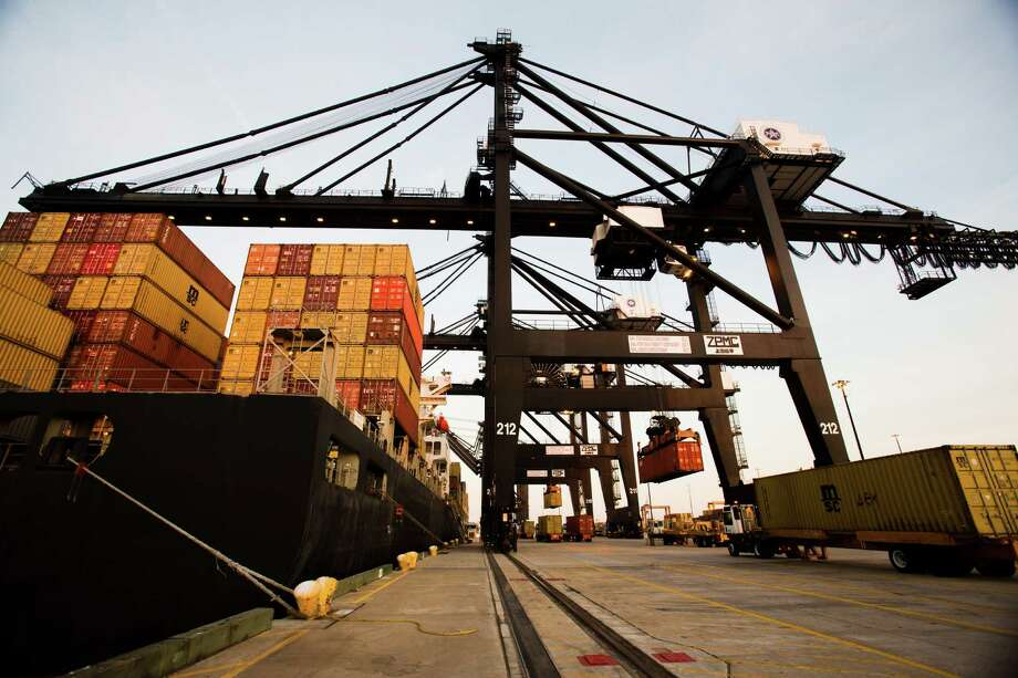 "Cargo moves through the Port of Houston last month. In a statement, the Port Authority says it ""remains hopeful an agreement will be resolved with a favorable outcome by the new deadline."" Photo: Eric Kayne / © 2012 Eric Kayne"