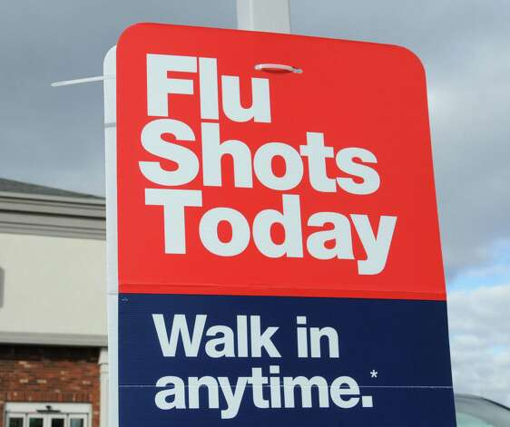 Flu vaccination sign outside a CVS Pharmacy on Wolf Road, Monday Jan. 14, 2013, in Colonie, N.Y. Some area pharmacies have experienced a shortage of vaccine following a recent flu outbreak. (Will Waldron/Times Union) Photo: Will Waldron