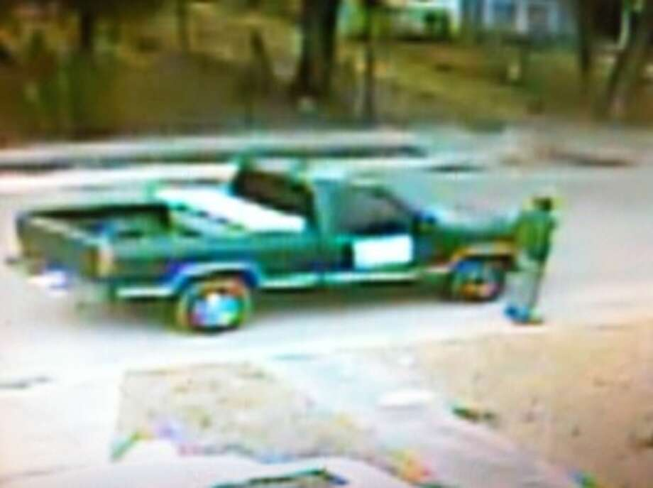 A suspect in a robbery-shooting at Alamo Auto Title in the 2100 block of Buffalo St., and his truck are pictured on Jan. 14. Photo: SAPD