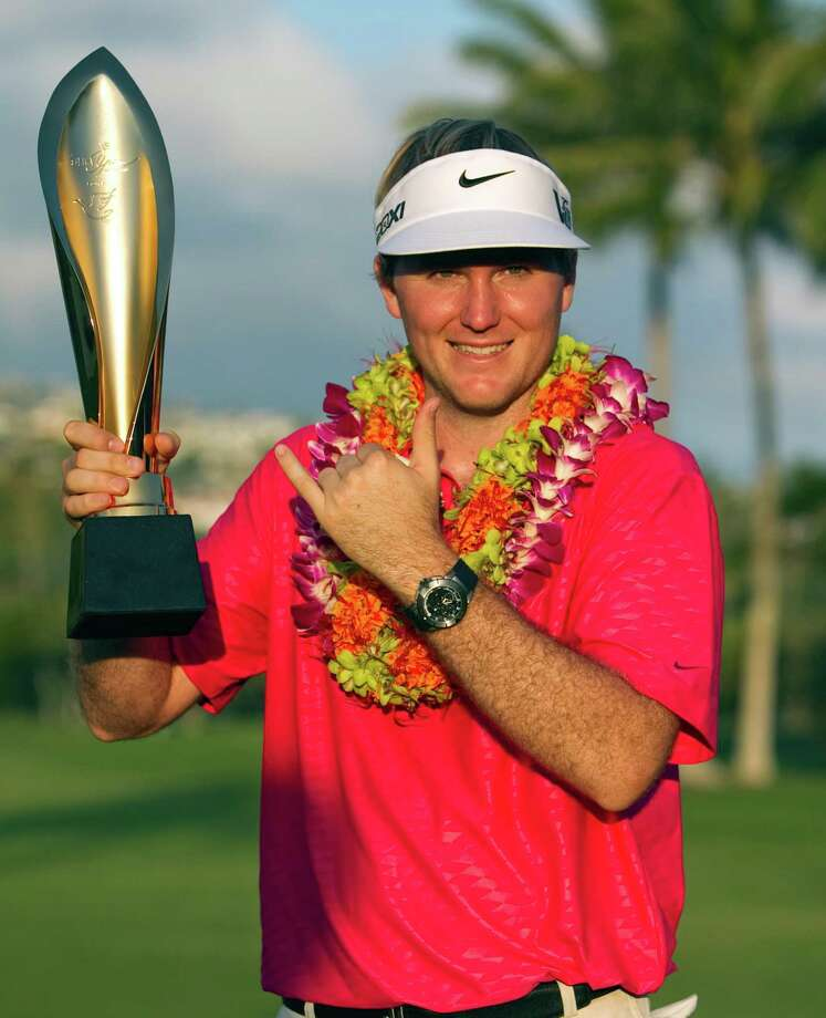 Russell Henley poses with the trophy after winning the Sony Open golf tournament, Sunday, Jan. 13, 2013, in Honolulu. (AP Photo/Marco Garcia) Photo: MARCO GARCIA