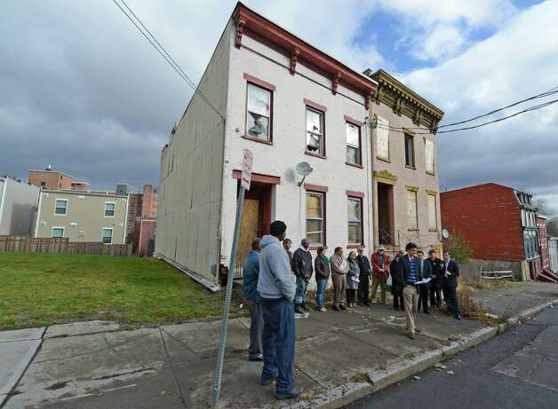 Activists and supporters gather in front of vacant buildings on Catherine Street to show their support of Albany County's plan to establish a landbank Jan. 14, 2013 in Albany, N.Y. (Skip Dickstein/Times Union) Photo: SKIP DICKSTEIN / 00020751A