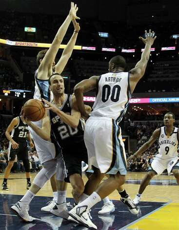 San Antonio Spurs guard Manu Ginobili (20), of Argentina, drives between Memphis Grizzlies center Marc Gasol, left, of Spain, forward Darrell Arthur (00) and guard Tony Allen (9) in the first half of an NBA basketball game on Friday, Jan. 11, 2013, in Memphis, Tenn. (AP Photo/Lance Murphey) Photo: Lance Murphey