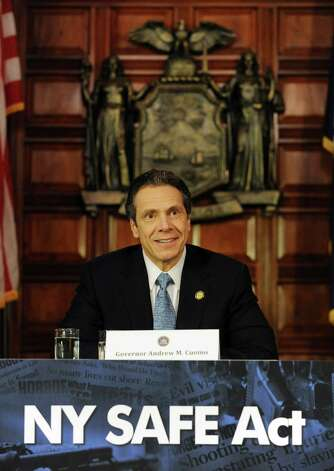 Governor Andrew Cuomo holds a press conference at the Capitol about a bill to broaden the state's definition of banned assault weapons, increase penalties for those convicted of gun crimes and create a statewide registry of assault rifles on Monday Jan. 14, 2013 in Albany, N.Y. (Lori Van Buren / Times Union) Photo: Lori Van Buren