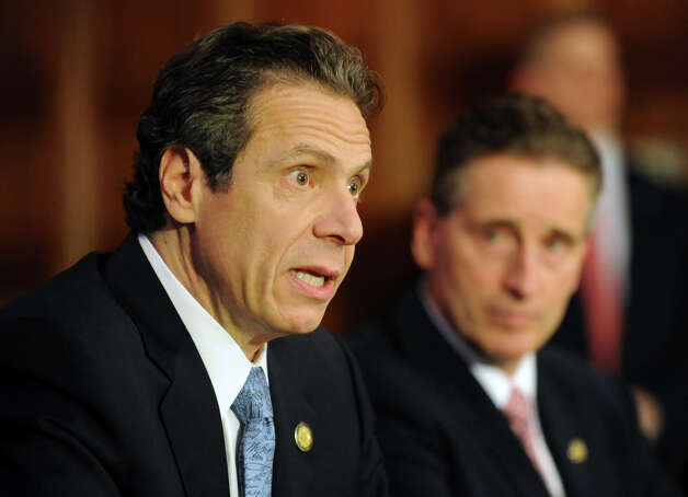 Governor Andrew Cuomo holds a press conference at the Capitol about a bill to broaden the state's definition of banned assault weapons, increase penalties for those convicted of gun crimes and create a statewide registry of assault rifles on Monday Jan. 14, 2013 in Albany, N.Y. Lt. Gov. Robert Duffy looks on at right.(Lori Van Buren / Times Union) Photo: Lori Van Buren