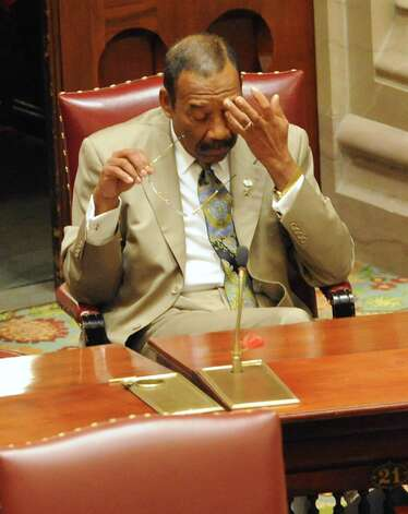 Senator Ruben Diaz, Sr. rubs his eyes before voting begins on a bill by Governor Andrew Cuomo to broaden the state's definition of banned assault weapons, increase penalties for those convicted of gun crimes and create a statewide registry of assault rifles on Monday Jan. 14, 2013 in Albany, N.Y. (Lori Van Buren / Times Union) Photo: Lori Van Buren