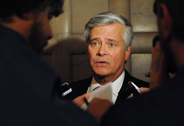 Senate Majority Leader Dean Skelos takes questions from the press before voting begins on a bill by Governor Andrew Cuomo to broaden the state's definition of banned assault weapons, increase penalties for those convicted of gun crimes and create a statewide registry of assault rifles on Monday Jan. 14, 2013 in Albany, N.Y. (Lori Van Buren / Times Union) Photo: Lori Van Buren