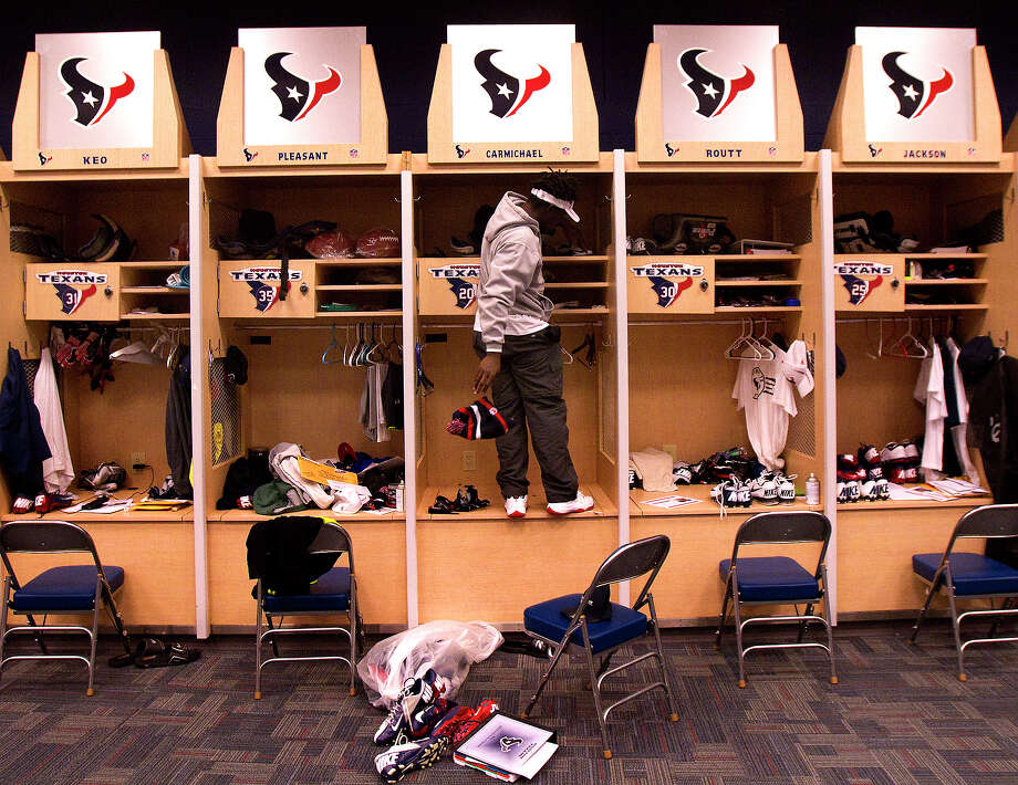 For perhaps the final time, Texans defensive back Roc Carmichael cleans out his locker Monday at Reliant Stadium. Carmichael is one of the team's free agents. Photo: Cody Duty, Staff / © 2012 Houston Chronicle