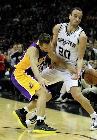 Spurs' Manu Ginobili (20) attempts a steal against Los Angeles Lakers' Steve Nash (10) in the first half at the AT&T Center on Wednesday, Jan. 9, 2013. Photo: Kin Man Hui, San Antonio Express-News / © 2012 San Antonio Express-News