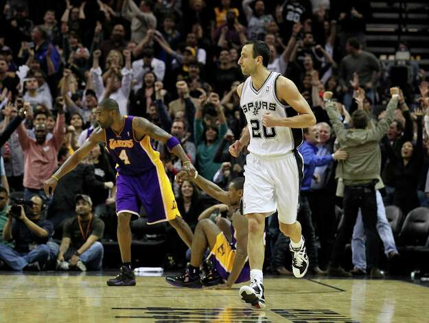 Spurs' Manu Ginobili (20) jogs up the court after sinking a big three-pointer against the Los Angeles Lakers in the fourth quarter at the AT&T Center on Wednesday, Jan. 9, 2013. Spurs defeated the Lakers, 108-105. Photo: Kin Man Hui, San Antonio Express-News / © 2012 San Antonio Express-News