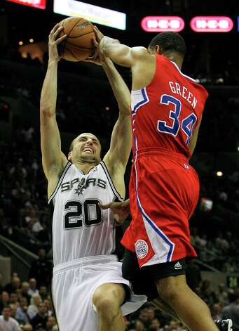 Spurs' Manu Ginobili (20) gets fouled by Los Angeles Clippers' Willie Green (34) in the second half of their game at the AT&T Center on Monday, Nov. 19, 2012. Clippers defeated the Spurs, 92-87. Photo: Kin Man Hui, San Antonio Express-News / © 2012 San Antonio Express-News