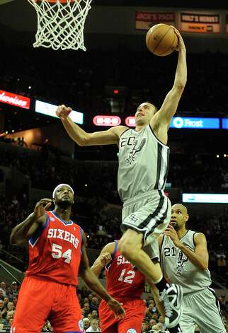Manu Ginobili of the San Antonio Spurs dunks over the Philadelphia 76ers during first-half NBA action in the AT&T Center on Saturday, Jan. 5, 2013. Photo: Billy Calzada, San Antonio Express-News / SAN ANTONIO EXPRESS-NEWS