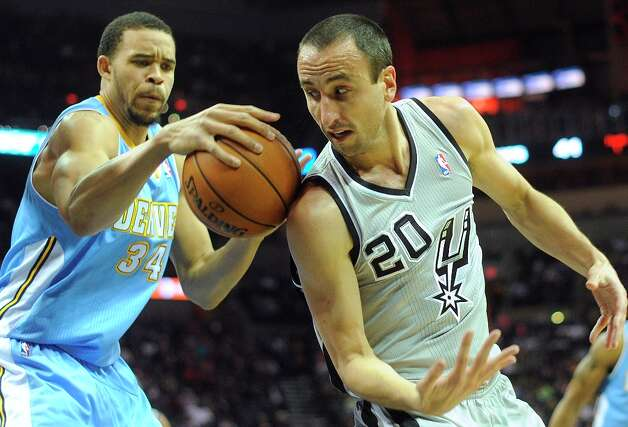 Manu Ginobili (20) of the San Antonio Spurs and JaVale McGee (34) of the Denver Nuggets battle for a loose ball during first-half NBA action in the Alamodome on Nov. 17, 2012. Photo: Billy Calzada, San Antonio Express-News / SAN ANTONIO EXPRESS-NEWS
