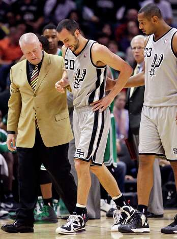 San Antonio Spurs' Manu Ginobili (center) is helped off the court by athletic trainer Will Sevening (left) and San Antonio Spurs' Boris Diaw after being injured during first half action against the Boston Celtics Saturday Dec. 15, 2012 at the AT&T Center. Photo: Edward A. Ornelas, San Antonio Express-News / © 2012 San Antonio Express-News