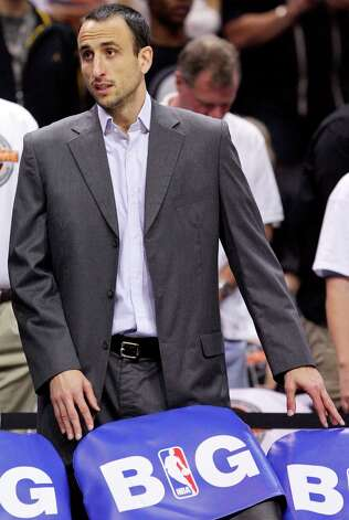 San Antonio Spurs' Manu Ginobili on the bench during first half action against the Oklahoma City Thunder Thursday Nov. 1, 2012 at the AT&T Center. Photo: Edward A. Ornelas, San Antonio Express-News / © 2012 San Antonio Express-News