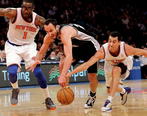 San Antonio Spurs guard Manu Ginobili (20) competes for a loose ball with New York Knicks forward Amare Stoudemire (1) and guard Pablo Prigioni (9) in the first half of their NBA basketball game at Madison Square Garden in New York, Thursday, Jan. 3, 2013. Photo: Kathy Willens, Associated Press / AP