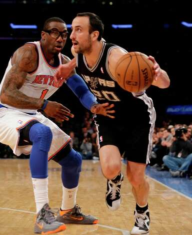New York Knicks forward Amar'e Stoudemire (1) defends San Antonio Spurs guard Manu Ginobili (20) in the first half of their NBA basketball game at Madison Square Garden in New York, Thursday, Jan. 3, 2013. Photo: Kathy Willens, Associated Press / AP