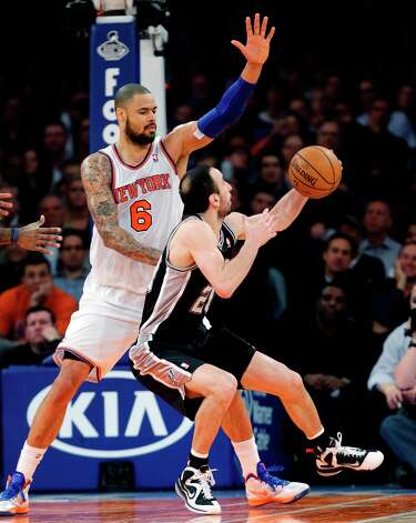 New York Knicks center Tyson Chandler (6) defends against San Antonio Spurs guard Manu Ginobili (20) in the second half of their NBA basketball game at Madison Square Garden in New York, Thursday, Jan. 3, 2013. The Knicks won 100-83. Photo: Kathy Willens, Associated Press / AP