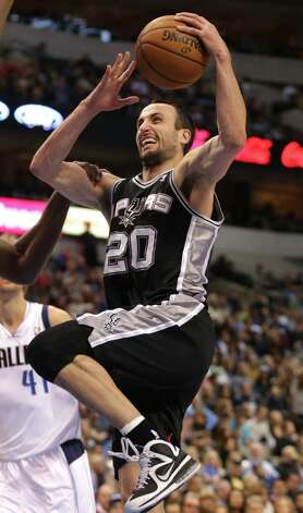 Spurs guard Manu Ginobili (20), of Argentina, during  an NBA basketball game against the Dallas Mavericks in Dallas on Sunday Dec. 30, 2012. San Antonio won 111-86. Photo: MIKE FUENTES, Associated Press / FR103746 AP