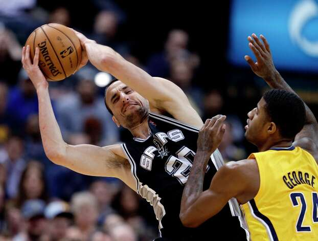 The Spurs' Manu Ginobili, left, keeps the ball from Indiana Pacers' Paul George during the second half of an NBA basketball game Friday, Nov. 23, 2012, in Indianapolis. The Spurs won 104-97. Photo: Darron Cummings, Associated Press / AP