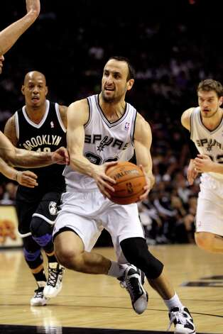The Spurs' Manu Ginobili drives the ball in the first half against the Brooklyn Nets at the AT&T Center, Monday, Dec. 31, 2012. Photo: Jerry Lara, San Antonio Express-News / © 2012 San Antonio Express-News