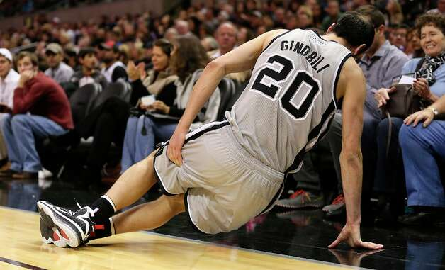 The Spurs' Manu Ginobili holds his left thigh during a play in the first half against the Minnesota Timberwolves at the AT&T Center, Sunday, Jan. 13, 2013. Photo: Jerry Lara, San Antonio Express-News / © 2013 San Antonio Express-News