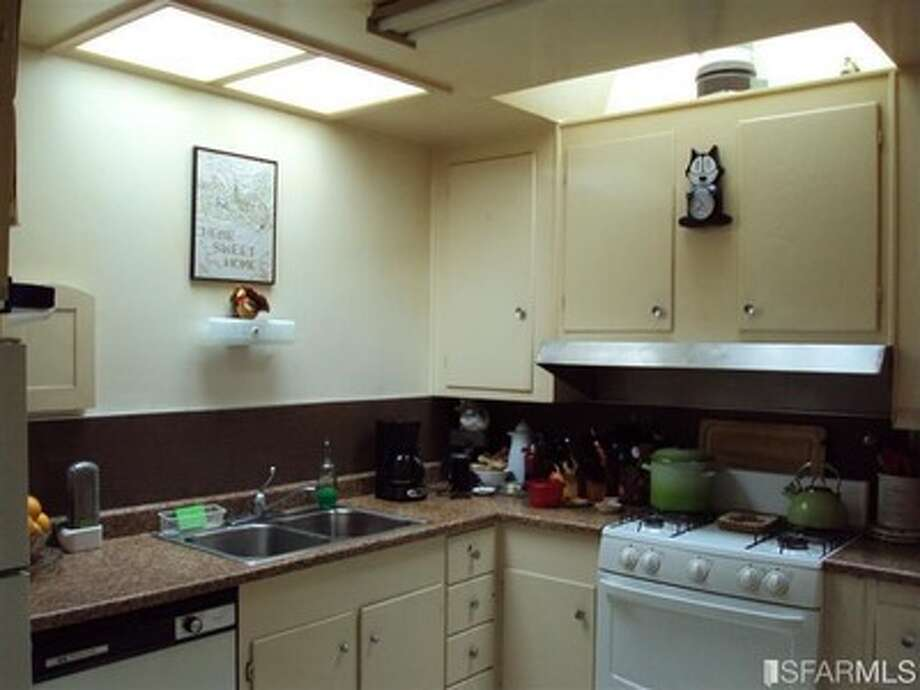 It looks like someone put a new countertop and a new stove in a very old kitchen.