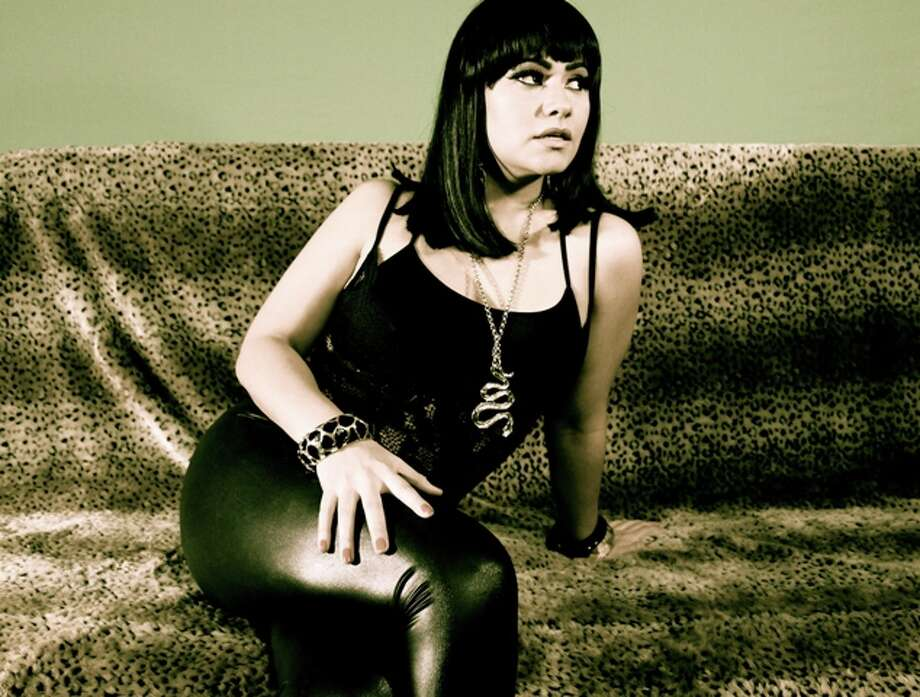 Houston pop singer Roxxi Jane is a bilingual diva with a rich, powerful voice. Music HERE. Photo: Promo Photo