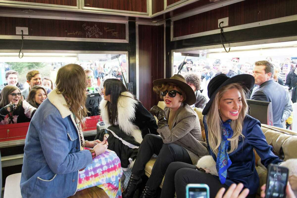 Just chilling -- with an audience. Lady Gaga sits with friends in the Born Brave Bus at the Tacoma Dome.