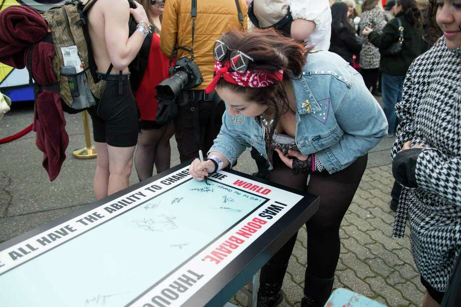 Katelyn signing a table in Lady Gaga's Monster Pit outside of the Tacoma Dome. Photo: CHONA KASINGER, FOR SEATTLEPI.COM / FOR SEATTLEPI.COM