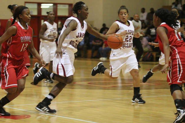 Shemiqua Spikes brings the ball upcourt against Diboll. Photo: Jason Dunn