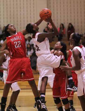 Shediqua Spkes goes hard to the bucket and draws Diboll defenders. Photo: Jason Dunn