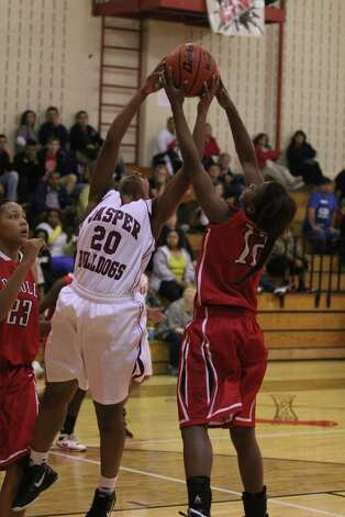 Tia Hunt battles a Diboll player for a rebound. Photo: Jason Dunn